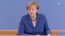 Link öffnet eine Lightbox. Video Merkel zur Willkommenskultur abspielen