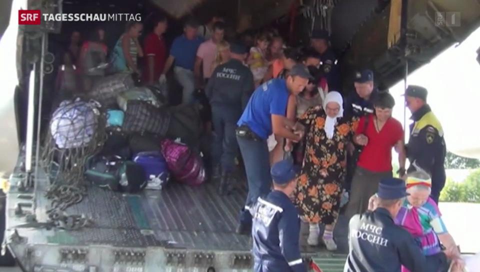 Menschen fliehen aus Lugansk
