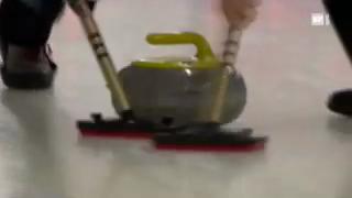 Wischen beim Curling