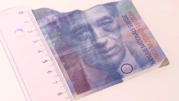 Video «Zerrissen oder verwaschen: Wann verliert die Banknote den Wert?» abspielen