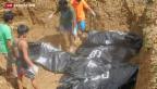 Video «Massenbegräbnisse auf den Philippinen» abspielen