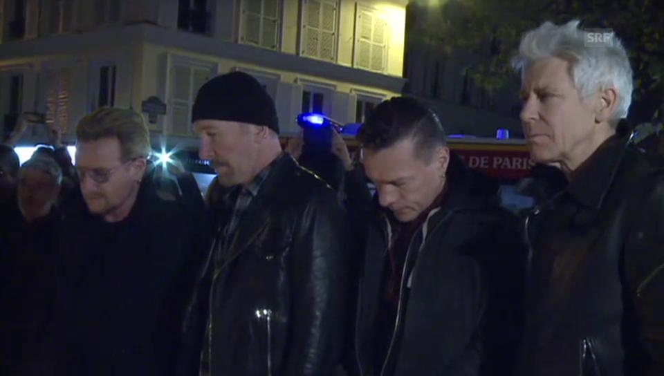 U2 legen in Paris Blumen nieder (unkomm.)