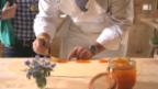 Video «Die Krapfen werden gefüllt und frittiert» abspielen