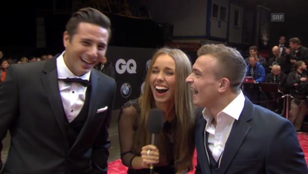 Video «GQ Awards 2013: Lacher auf dem roten Teppich (unkommentiert)» abspielen