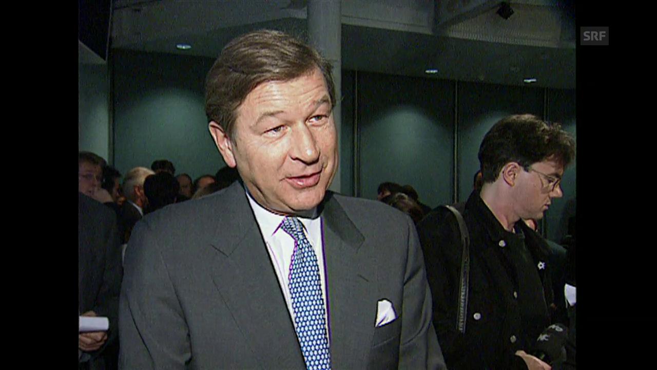 Marcel Ospel erklärt am Tag der Fusion seine Ziele für die UBS