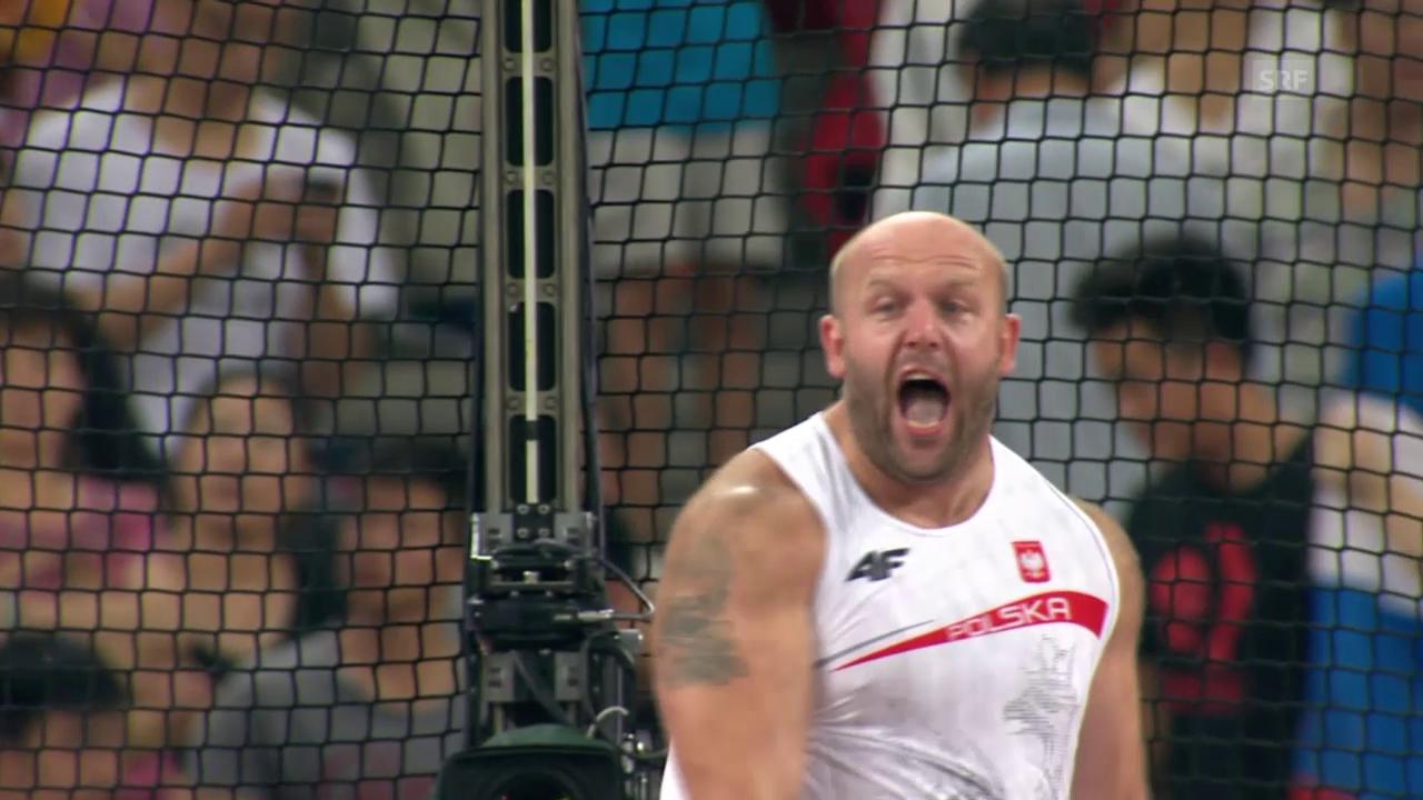 Leichtathletik: WM in Peking, Entscheidung Diskus Männer, Sieg Malachowski
