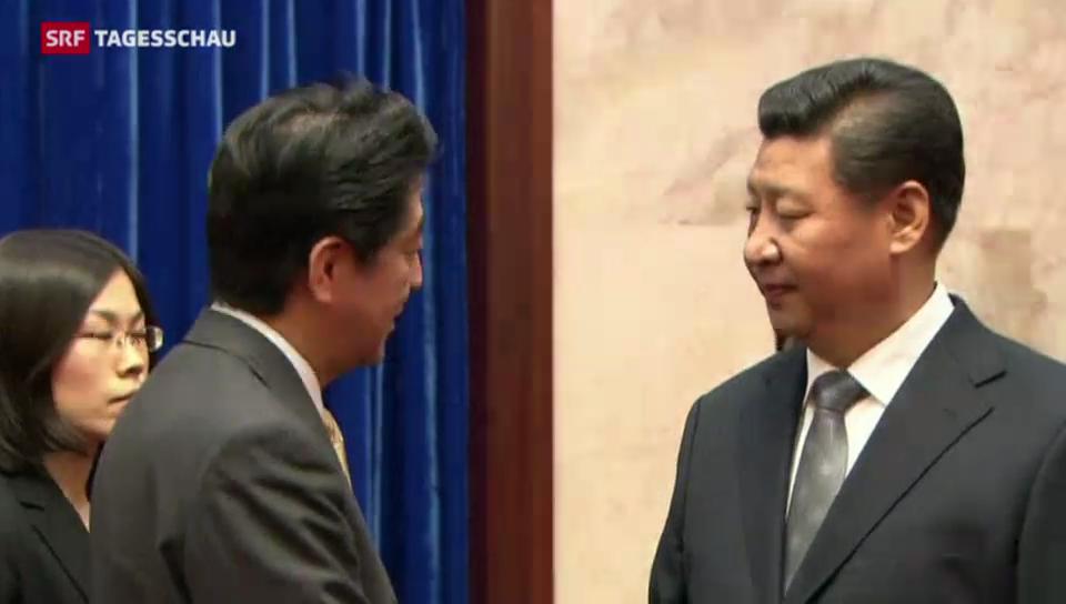 Handschlag zwischen Japan und China