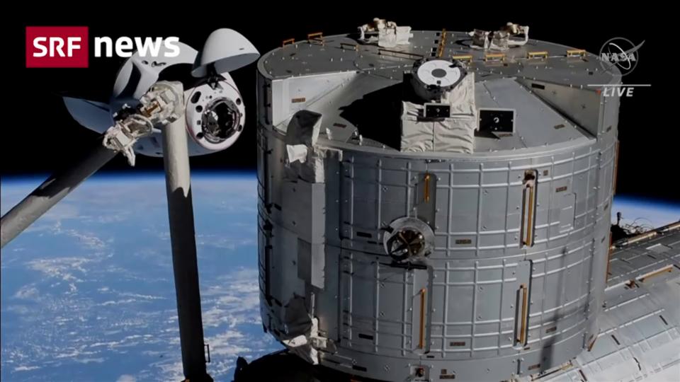Aus dem Archiv: Vier Astronauten an der ISS angekommen