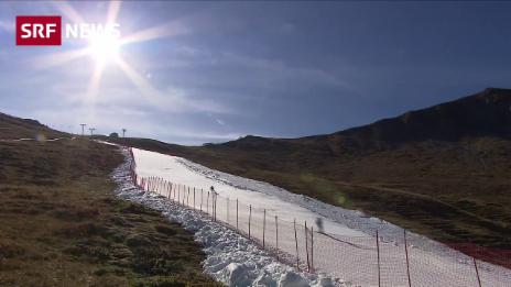Link öffnet eine Lightbox. Video Skifahrer in Adelboden kurven über Altschnee abspielen