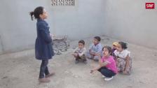 Link öffnet eine Lightbox. Video Kinder träumen von Schulbildung abspielen