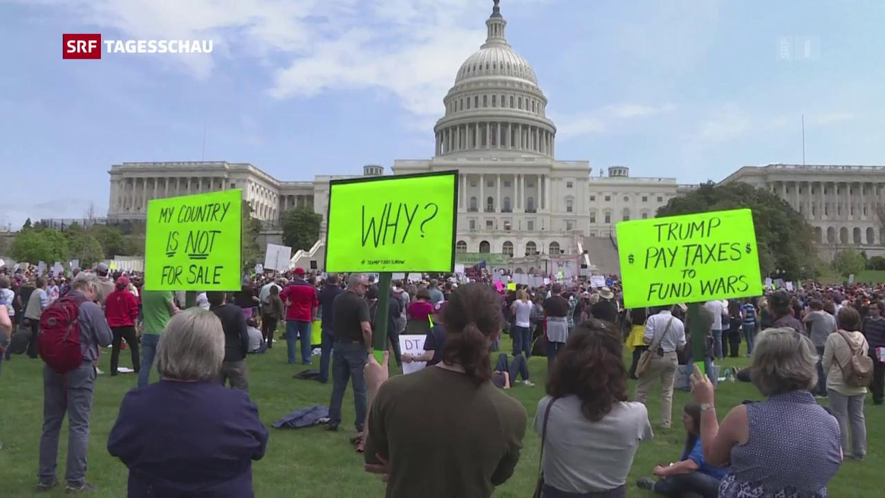 Demos quer durch die USA fordern Steuer-Ehrlichkeit von Trump