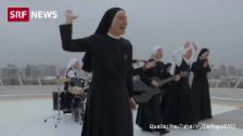 Link öffnet eine Lightbox. Video Rockende Nonnen singen am Weltjugendtag für Papst abspielen