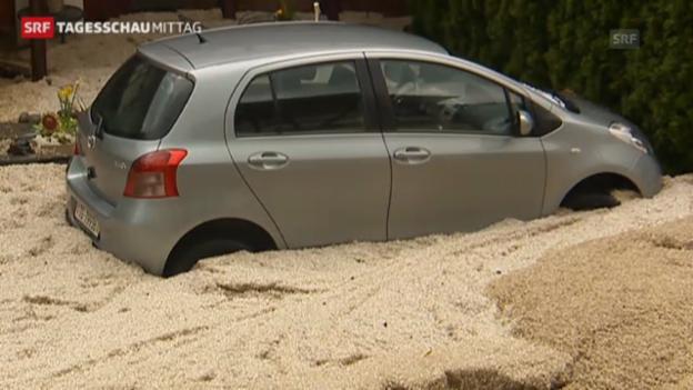 Video «Überflutete Strassen und Keller nach Unwetter (Tagesschau Mittag 3.5.2013)» abspielen