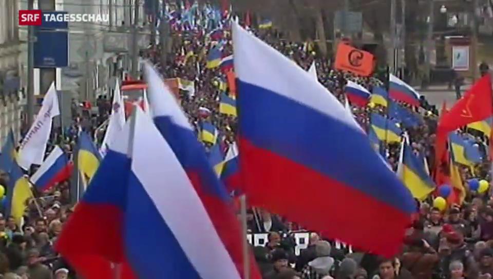 Krim: tausende Moskauer gegen Putin