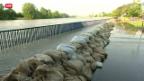 Video «Dammbrüche wegen Hochwasser» abspielen