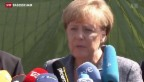 Video «Merkel besucht Flüchtlings-Unterkunft in Heidenau» abspielen