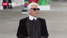 Link öffnet eine Lightbox. Video Karl Lagerfeld fehlt an eigener Modeschau abspielen