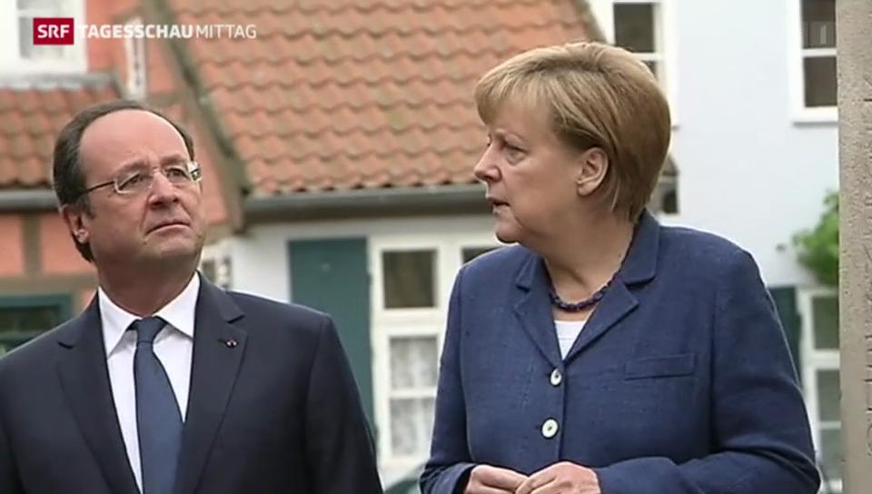 Hollande und Merkel rufen zum Dialog auf