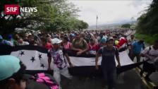 Link öffnet eine Lightbox. Video Karawane von Migranten unterwegs abspielen
