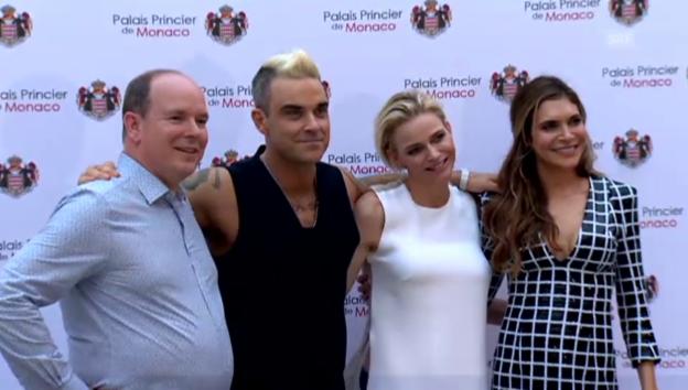 Video «Charlène und Albert treffen Robbie Williams (unkomm.)» abspielen