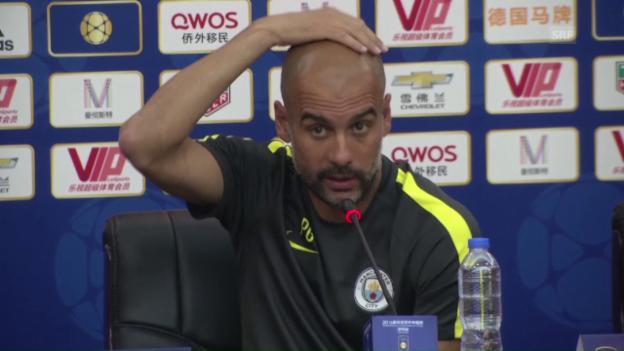 Video «Guardiola nervt sich über die Platzverhältnisse in Peking (SNTV)» abspielen
