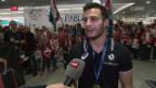 Video «Grosser Bahnhof am Flughafen: Fans warten auf Brägger und Co.» abspielen