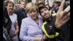 Video «Im Menschenbad: Angela Merkel auf Staatsbesuch» abspielen