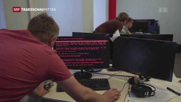 Video «Sieben Schweizer Firmen vom Cyber-Angriff betroffen» abspielen