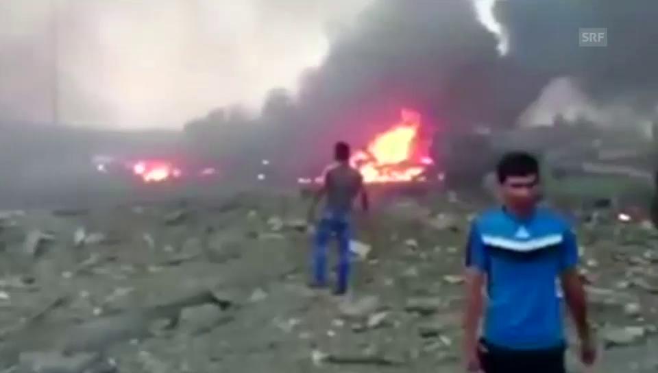 Brennende Gebäude, Autowracks, verzweifelte Menschen (unkommentiert)