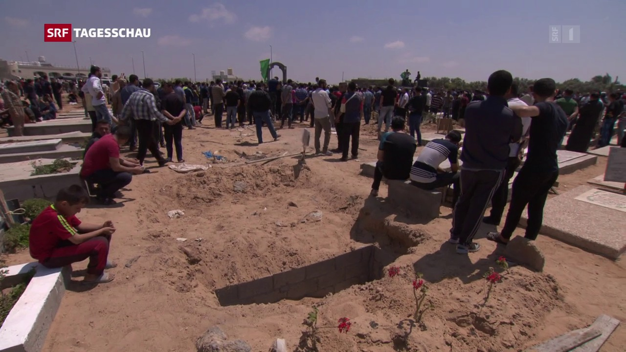 Reportage: Die Toten werden beigesetzt