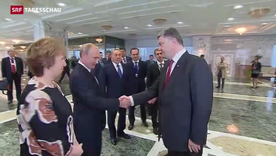 Handschlag zwischen Putin und Poroschenko