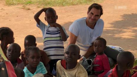 Link öffnet eine Lightbox. Video Roger Federer in Sambia abspielen