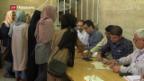 Video «Iraner gehen in Massen an die Urnen» abspielen