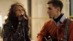Video «Aerosmith musiziert mit Strassenmusiker» abspielen